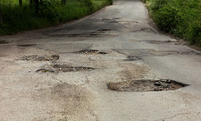 HOW ROAD CONSTRUCTION & POTHOLES CAN AFFECT YOUR CAR